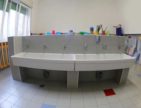 bathroom with sinks for cleaning inside the nursery