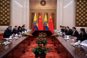 China's Premier Li Keqiang speaks to Ecuadorean President Lenin Moreno during a meeting at the Great Hall of the People in Beijing