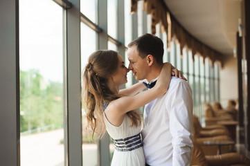 Romantic wedding moment, couple of newlyweds smiling portrait, bride and groom hug.