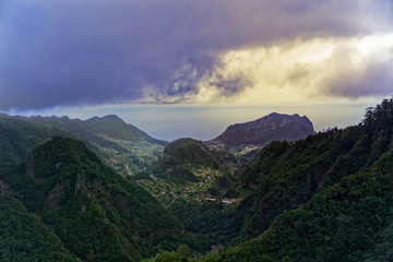Aerial view from Balcoes viewpoint at green hills and mountains in Faial county, Madeira
