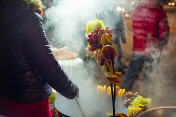 making fruity mulled wine at Christmas market in Budapest
