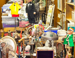 Old vintage objects and furniture for sale at a flea market