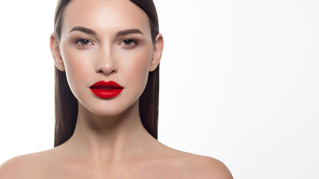 Close-up portrait of sexy european young woman model with classic glamour make-up and red lipstick. Dark long hairstyle, christmas makeup, dark eyeshadows, bloody red lips with gloss