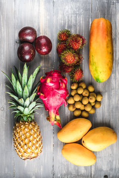 Set of exotic fruits. Assorted tropical fruits of pineapple, dragon fruit, rambutan, passion fruit, mango, longan, papaya