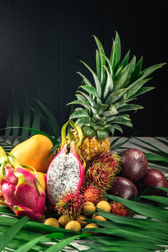 Set of exotic fruits. Assorted tropical fruits of pineapple, rambutan, passion fruit, mango, dragon fruit, longan