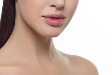 Closeup of beautiful female mouth with natural lip makeup.