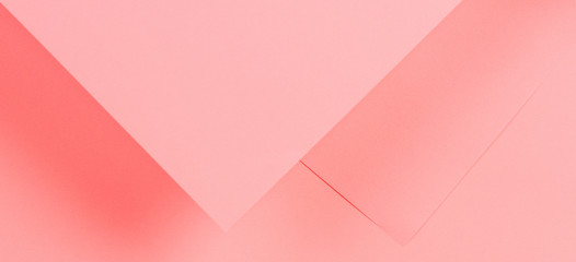 Abstract geometric shape living coral color paper background