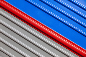 gray-blue background with a diagonal red stripe
