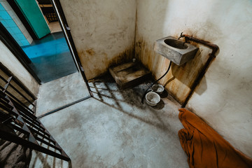 Dirty sink near entrance of jail cell