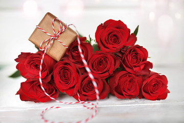Red roses with a gift