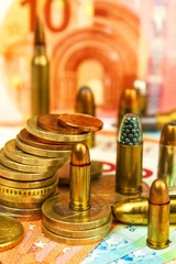 Euro coins and banknotes and cartridges of different caliber. Illegal trade in ammunition. Sale of weapons. Financing terrorism.