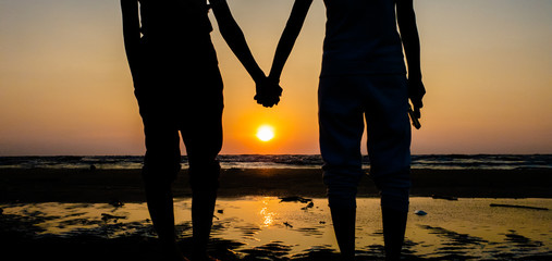 Asian of couple Lesbian romantic clap hand on the beach Sunset background Summer honeymoon vacation and holidays shoot photo by smart phone