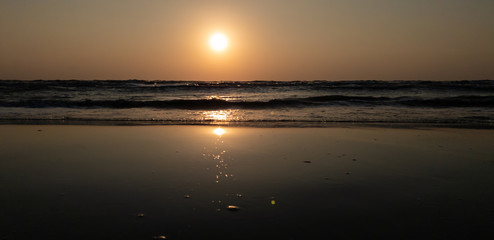 Beach sunset and incredible foamy waves in evening. Summer  holiday and vacation