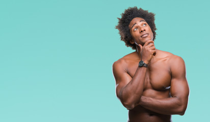 Afro american shirtless man showing nude body over isolated background with hand on chin thinking about question, pensive expression. Smiling with thoughtful face. Doubt concept.