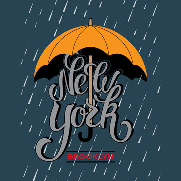 New York brush lettering with umbrella and raindrop.