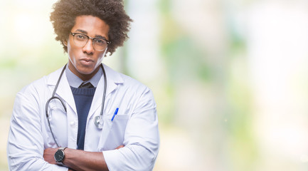 Afro american doctor man over isolated background skeptic and nervous, disapproving expression on face with crossed arms. Negative person.