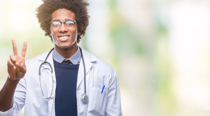 Afro american doctor man over isolated background showing and pointing up with fingers number two while smiling confident and happy.
