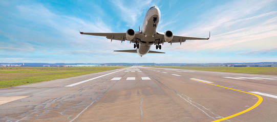 Airplane take off from the airport - Travel by air transport