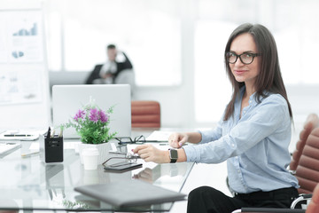 successful business woman on work place in office