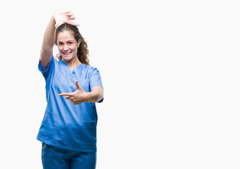 Young brunette doctor girl wearing nurse or surgeon uniform over isolated background smiling making frame with hands and fingers with happy face. Creativity and photography concept.
