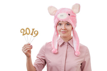 young girl in a pig costume holding in her hands the numbers of 2019, in anticipation of the New Year