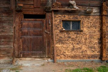 Old wooden barn in mountain Wengen village in Lauterbrunnen region in Switzerland.