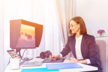 Woman using digital drawing monitor in the office