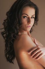 Beautiful woman with brown hair posing and looking at camera