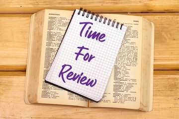 Writing note showing Time For Review on notebook