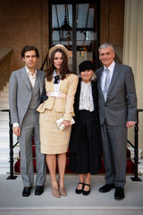 British actor Keira Knightley, her husband James Righton and her parents Sharman Knightley and Kevin William Knightley, pose for the media after she was awarded an OBE for her services to drama and charity at an investiture ceremony at Buckingham Palace
