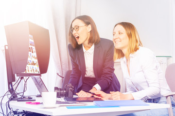 Businesswomen finding the right images for project