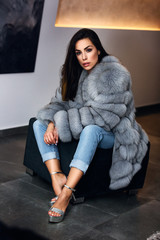 High fashion model in winter fur coat clothes