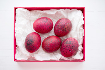 Red Easter eggs in a gift red box, the top view.