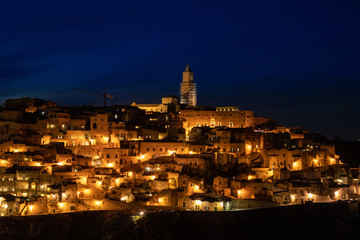 Panorama of Matera and Gravina by night seen from the archaeological park of the Murge Materane, Basilicata, Italy