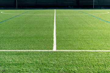 Soccer field with new artificial turf. Soccer background. Copy space
