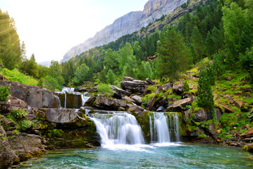 Waterfall in Ordesa and Monte Perdido National Park. Pyrenees mountain. Province of Huesca, Spain. Wall mural