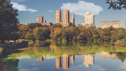 Reflections of famous Upper West Side buildings on the Lake, Central Park, New York City, USA