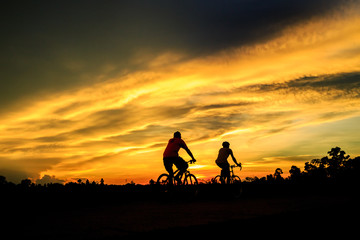 silhouette of cyclist on background of sunset