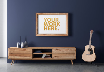 Wooden Framed Print Hanging on Blue Wall Mockup