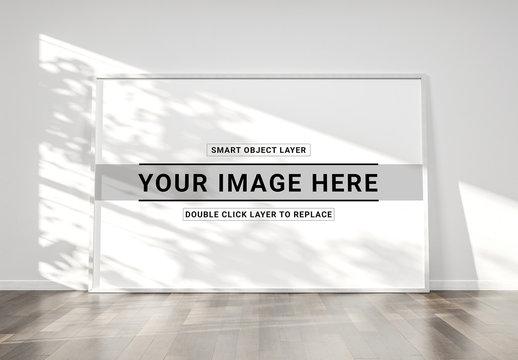 Large White Frame Against White Wall Mockup
