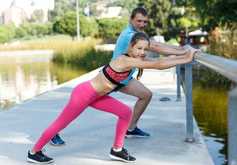 Girl stretching together with father