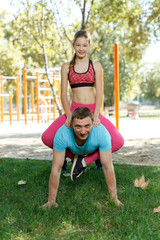 Man doing push-ups with daughter on back