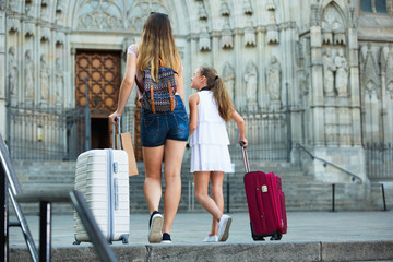Back view of  woman with daughter travelling together