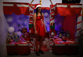 "A prisoner poses for a photo during a Christmas decorating event ""Bright prison cell"" at the Nelson Hungria prison in Rio de Janeiro"