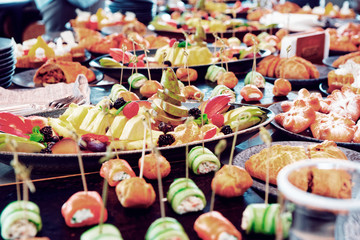 A lot of various food on catering table, toned