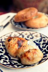 Uzbek samosa on restaurant table, toned