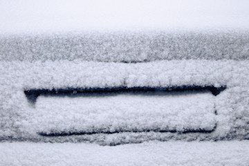 frozen car glass, car glass in ice with snow, frost, snowfall