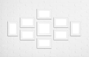 Frames collage. Blank frameworks mock up on white bricks wall