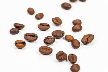 Roasted coffee beans isolated on white background, angle view