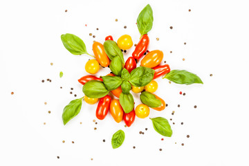 Centered composition of basil, pepper and cherry tomatoes, on white background
